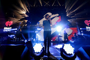 IMAGE WAS PROCESSED USING DIGITAL FILTERS)Recording artist Louis Tomlinson of music group One Direction performs onstage during 102.7 KIIS FMÂ's Jingle Ball 2015 Presented by Capital One at STAPLES CENTER on December 4, 2015 in Los Angeles, California.