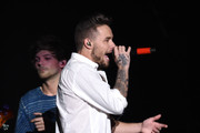 Recording artists Louis Tomlinson (L) and Liam Payne of One Direction perform onstage during 102.7 KIIS FMÂ's Jingle Ball 2015 Presented by Capital One at STAPLES CENTER on December 4, 2015 in Los Angeles, California.