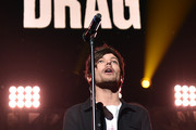 Singer Louis Tomlinson of musical group One Direction performs onstage during 106.1 KISS FM's Jingle Ball 2015 presented by Capital One at American Airlines Center on December 1, 2015 in Dallas, Texas.