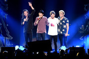 (L-R) Singer Harry Styles, Liam Payne, Louis Tomlinson, and Niall Horan of One Direction perform onstage during 106.1 KISS FM's Jingle Ball 2015 presented by Capital One at American Airlines Center on December 1, 2015 in Dallas, Texas.