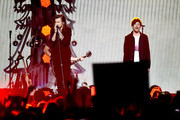 Singers Harry Styles (L) and Louis Tomlinson of One Direction perform onstage during 106.1 KISS FM's Jingle Ball 2015 presented by Capital One at American Airlines Center on December 1, 2015 in Dallas, Texas.