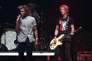 Musicians Aaron Bruno (L) and Duff McKagan of Awolnation perform onstage during 106.7 KROQ Almost Acoustic Christmas 2015 at The Forum on December 12, 2015 in Los Angeles, California.