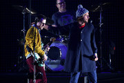 (L-R) Musicians Rivers Cuomo and Patrick Wilson of Weezer and Aaron Bruno of Awolnation perform onstage during 106.7 KROQ Almost Acoustic Christmas 2015 at The Forum on December 12, 2015 in Los Angeles, California.