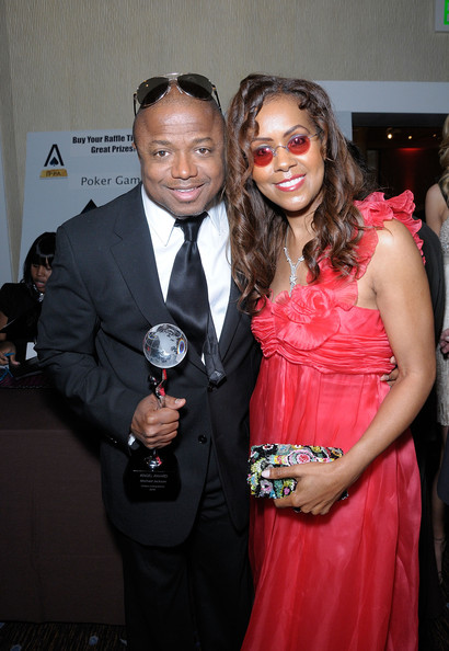 "Musician Randy Jackson and TV personality April Sutton pose with the ""Angel Award"" presented to Jackson on behalf of his late brother Michael Jackson at the 11th Annual Children Uniting Nations Oscar Celebration, held at the Beverly Hilton Hotel on March 7, 2010 in Beverly Hills, California."
