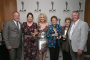 (L-R) Academy of Country Music CEO Pete Fisher, Pam Miller, Cam, Bobbie Hedrick, Garneta Johnston and Chris Christensen take photos during the 12th Annual ACM Honors at Ryman Auditorium on August 22, 2018 in Nashville, Tennessee.