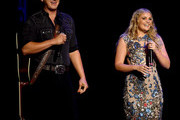 Jon Paradi (L) and Lauren Alaina speak onstage during the 12th Annual ACM Honors at Ryman Auditorium on August 22, 2018 in Nashville, Tennessee.