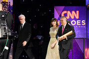 (L-R) Ted Danson and Mary Steenburgen present an award to 2018 CNN Hero Dr. Ricardo Pun-Chong during the 12th Annual CNN Heroes: An All-Star Tribute  at American Museum of Natural History on December 9, 2018 in New York City.