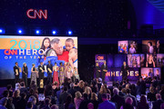 (L-R) 2018 Top 10 CNN Heroes Luke Mickelson, Florence Phillips, Ellen Stackable, Chris Stout, Hero of the Year Dr. Ricardo Pun-Chong, Dr. Rob Gore, Maria Rose Belding, Abisoye Ajayi-Akinfolarin, Susan Munsey, and Amanda Boxtel pose onstage with Kelly Ripa and Anderson Cooper during the 12th Annual CNN Heroes: An All-Star Tribute  at American Museum of Natural History on December 9, 2018 in New York City.