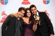 (L-R) Musicians Jorge Villamizar, Lena Burke and Alex Ubago of the band Alex, Jorge y Lena pose with the Best Pop Album by a Duo/Group with Vocals Award in the press room during the 12th annual Latin GRAMMY Awards at the Mandalay Bay Resort & Casino on November 10, 2011 in Las Vegas, Nevada.