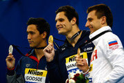 (L-R) Eugene Godsoe of the USA, Florent Manaudou of France and Stanislav Donect of Russia celebrate on the podium after the Men's 50m Backstroke Final during day four of the 12th FINA World Swimming Championships (25m) at the Hamad Aquatic Centre on December 6, 2014 in Doha, Qatar.