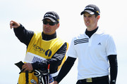 Justin Rose of England lines up a shot with caddy Mark Fulcher during the final round of the 138th Open Championship on the Ailsa Course, Turnberry Golf Club on July 19, 2009 in Turnberry, Scotland.
