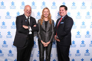 Host Andrew Zimmern; Christina Tosi, event Co-chair, Chef, Founder and Owner, Milk Bar; and Matt Higgins, event Co-chair and Co-founder and CEO, RSE Ventures, recurring shark, Shark Tank attend the 13th Annual Autism Speaks Celebrity Chef Gala at Cipriani Wall Street on October 15, 2019 in New York City.