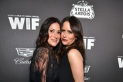 (L-R) Angelique Cabral and Amy Landecker attend the 13th annual Women In Film Female Oscar Nominees Party presented by Max Mara, Stella Artois, Cadillac, and Tequila Don Julio, with additional support from Vero Water at Sunset Room on February 07, 2020 in Hollywood, California.