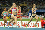 Jennifer Barringer Simpson of United States approaches the finish line to claim gold ahead of (L-R) Kalkidan Gezahegne of Ethiopia, Btissam Lakhouad of Morocco, Hannah England of Great Britain and Natalia Rodriguez of Spain during the women's 1500 metres final during day six of the 13th IAAF World Athletics Championships at the Daegu Stadium on September 1, 2011 in Daegu, South Korea.