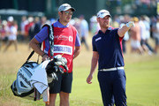 John Singleton of England chats with his caddie on the fifth hole during the first round of The 143rd Open Championship at Royal Liverpool on July 17, 2014 in Hoylake, England.