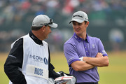 Justin Rose of England chats with caddie Mark Fulcher during the third round of The 143rd Open Championship at Royal Liverpool on July 19, 2014 in Hoylake, England.