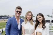 (L-R) Robin Thicke, President of The Stronach Group Belinda Stronach, and Actress Victoria Justice at The Stronach Group Chalet at the 144th Preakness Stakes at Pimlico Race Track on May 18, 2019 in Baltimore, Maryland.
