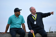Denis Pugh, coach of Francesco Molinari of Italy (R) and Francesco Molinari of Italy (L) look on during a practice round prior to the 148th Open Championship held on the Dunluce Links at Royal Portrush Golf Club on July 16, 2019 in Portrush, United Kingdom.