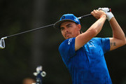 Rickie Fowler of the United States plays a shot  during a practice round prior to the 148th Open Championship held on the Dunluce Links at Royal Portrush Golf Club on July 16, 2019 in Portrush, United Kingdom.