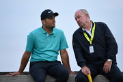 Denis Pugh, coach of Francesco Molinari of Italy (R) and Francesco Molinari of Italy (L) speak during a practice round prior to the 148th Open Championship held on the Dunluce Links at Royal Portrush Golf Club on July 16, 2019 in Portrush, United Kingdom.
