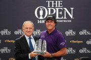 Official World Golf Ranking Chairman Peter Dawson presents Phil Mickelson of The United States with an award for spending the last 25 years in the top 50 best ranked players in the World official ranking during a practice round prior to the 148th Open Championship held on the Dunluce Links at Royal Portrush Golf Club on July 16, 2019 in Portrush, United Kingdom.