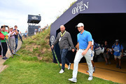 Rory McIlroy of Northern Ireland and Thomas Bjorn of Denmark walk during a practice round prior to the 148th Open Championship held on the Dunluce Links at Royal Portrush Golf Club on July 16, 2019 in Portrush, United Kingdom.