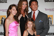 Actor Sylvester Stallone (R), daughters Sophia Rose Stallone (L) and Scarlet Rose Stallone (C, foreground) and wife Jennifer Flavin attend the 14th annual Hollywood Awards Gala at The Beverly Hilton Hotel on October 25, 2010 in Beverly Hills, California.