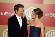 Actor Robert Downey Jr. (L) and producer Susan Downey attends the 14th Annual Warner Bros. And InStyle Golden Globe Awards After Party held at the Oasis Courtyard at the Beverly Hilton Hotel on January 13, 2013 in Beverly Hills, California.