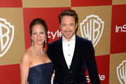 Actor Robert Downey Jr. (R) and producer Susan Downey attends the 14th Annual Warner Bros. And InStyle Golden Globe Awards After Party held at the Oasis Courtyard at the Beverly Hilton Hotel on January 13, 2013 in Beverly Hills, California.