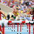 Sally Pearson Photos - (L-R) Queen Harrison of the United States, Sally Pearson of Australia and Dawn Harper of the United States  compete in the Women's 100 metres hurdles semi finals during Day Eight of the 14th IAAF World Athletics Championships Moscow 2013 at Luzhniki Stadium on August 17, 2013 in Moscow, Russia. - 14th IAAF World Athletics Championships Moscow 2013 - Day Eight