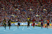 Usain Bolt of Jamaica crosses the line to win gold ahead of (L-R) Anaso Jobodwana of South Africa, Nickel Ashmeade of Jamaica, Adam Gemili of Great Britain, Curtis Mitchell of the United States, Jaysuma Saidy Ndure of Norway and Churandy Martina of the Netherlands in the Men's 200 metres final during Day Eight of the 14th IAAF World Athletics Championships Moscow 2013 at Luzhniki Stadium on August 17, 2013 in Moscow, Russia.
