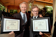 Directors Clint Eastwood (L) and Steven Spielberg pose with awards during the 15th Annual AFI Awards at Four Seasons Hotel Los Angeles at Beverly Hills on January 9, 2015 in Beverly Hills, California.