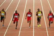 (L-R) Asafa Powell of Jamaica, Justin Gatlin of the United States, Tyson Gay of the United States, Usain Bolt of Jamaica and Mike Rodgers of the United States cross the finish line in the Men's 100 metres final during day two of the 15th IAAF World Athletics Championships Beijing 2015 at Beijing National Stadium on August 23, 2015 in Beijing, China.