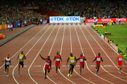 Usain Bolt of Jamaica (C) wins gold ahead of (L-R) Andre De Grasse of Canada, Asafa Powell of Jamaica, Justin Gatlin of the United States, Tyson Gay of the United States, Mike Rodgers of the United States, Trayvon Bromell of the United States and Bingtian Su of China as they cross the finish line in the Men's 100 metres final during day two of the 15th IAAF World Athletics Championships Beijing 2015 at Beijing National Stadium on August 23, 2015 in Beijing, China.