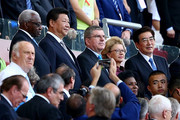 (L-R) Outgoing president of the IAAF Lamine Diack, President of the People's Republic of China Xi Jinping and President of the IOC Thomas Bach with wife Claudia during the Opening Ceremony for the 15th IAAF World Athletics Championships Beijing 2015 at Beijing National Stadium on August 22, 2015 in Beijing, China.
