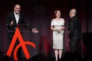 Actress Julianne Moore (C) presents the award for Designer of the Year to Ulrich Grimm (L), Francisco Costa, and Italo Zucchelli at the 16th Annual ACE Awards presented by the Accessories Council at Cipriani 42nd Street on November 5, 2012 in New York City.