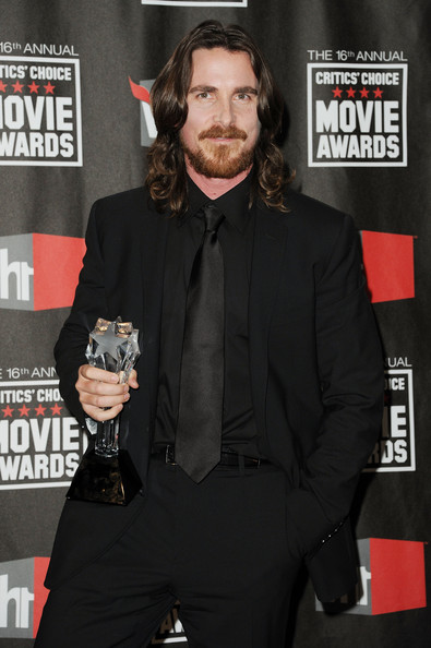 "Actor Christian Bale poses with the Best Supporting Actor award for ""The Fighter"" in the press room during the 16th annual Critics' Choice Movie Awards at the Hollywood Palladium on January 14, 2011 in Los Angeles, California."