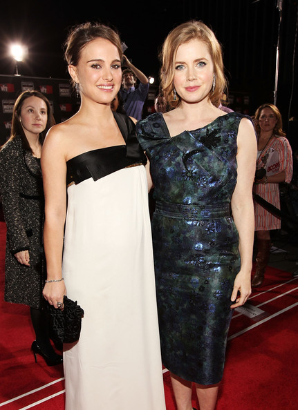 Actress Natalie Portman (L) and Amy Adams arrive at the 16th annual Critics' Choice Movie Awards at the Hollywood Palladium on January 14, 2011 in Los Angeles, California.