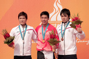 (L-R) Silver medallist kifumi Sakamoto, Gold medallist Steven P.m.j Wong of Hong Kong and Bronze Medallist Masahiro Sampei of Jpaan in the Men's BMX Raceat Guangzhou Velodrome during day seven of the 16th Asian Games Guangzhou 2010 on November 19, 2010 in Guangzhou, China.
