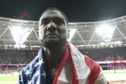 Justin Gatlin of the United States wears his national flag on his shoulders on his lap of honour following his win in the Men's 100 metres Final in 9.92 seconds during day two of the 16th IAAF World Athletics Championships London 2017 at The London Stadium on August 5, 2017 in London, United Kingdom.
