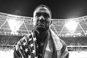 This images was converted to black and white) Justin Gatlin of the United States wears his national flag on his shoulders on his lap of honour following his win in the Men's 100 metres Final in 9.92 seconds during day two of the 16th IAAF World Athletics Championships London 2017 at The London Stadium on August 5, 2017 in London, United Kingdom.