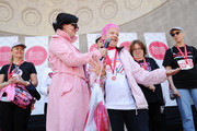 Actress Karen Duffy appears on stage with participants at the 17th Annual EIF Revlon Run Walk For Women on May 3, 2014 in New York City.