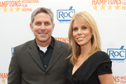 """Producer Andy Ostroy and Director Cheryl Hines arrive at the 17th annual Hamptons International Film Festival premiere of """"Serious Moonlight"""" at the United Artists Regal Cinema on October 8, 2009 in East Hampton, New York."""