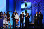 (L-R) Actors Misty Upham, Juliette Lewis, Julianne Nicholson, Dermot Mulroney, Julia Roberts, Chris Cooper and Margo Martindale accept the Hollywood Ensemble Cast Award for 'August: Osage County,' as director John Wells and presenter Garry Marshall look on, onstage during the 17th annual Hollywood Film Awards at The Beverly Hilton Hotel on October 21, 2013 in Beverly Hills, California.