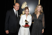 Natalia Lafourcade (C) poses with the Best Folk Album award with Latin Recording Academy Chairs Eduardo Hutt (L) and Eva Cebrian (R) at the Premiere Ceremony during the 19th Annual Latin GRAMMY Awards at MGM Grand Hotel & Casino on November 15, 2018 in Las Vegas, Nevada.