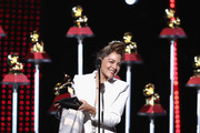 Natalia Lafourcade accepts the award for Best Folk Album onstage at the Premiere Ceremony during the 19th Annual Latin GRAMMY Awards at MGM Grand Hotel & Casino on November 15, 2018 in Las Vegas, Nevada.