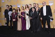 "(L-R) Actors Ty Burrell, Aubrey Anderson-Emmons, Nolan Gould, Ariel Winter, Sarah Hyland, Sofia Vergara, Jesse Tyler Ferguson, Eric Stonestreet, Rico Rodriguez, Julie Bowen and Ed O'Neill, winners of Outstanding Performance by an Ensemble in a Comedy Series for ""Modern Family,"" pose in the press room during the 19th Annual Screen Actors Guild Awards held at The Shrine Auditorium on January 27, 2013 in Los Angeles, California."