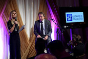 Tracie Hamilton of J/P Haitian Relief Organization (L) and comedian Kevin Nealon speak onstage during the 1st Annual Nashville Shines for Haiti concert benefiting J/P Haitian Relief Organization - Day 2 hosted by Johnathon Arndt and Newman Arndt on April 27, 2016 in Nashville, Tennessee.
