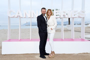 """Alexandre Brasseur and Ingrid Chauvin from the serie """"Demain nous appartient"""" attend a photocall during the 1st Cannes International Series Festival on April 9, 2018 in Cannes, France."""
