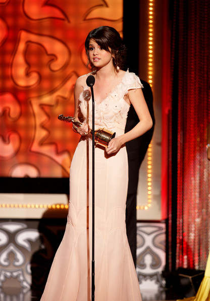 Selena Gomez Actress Selena Gomez accepts her Year in Television Comedy Actress award for